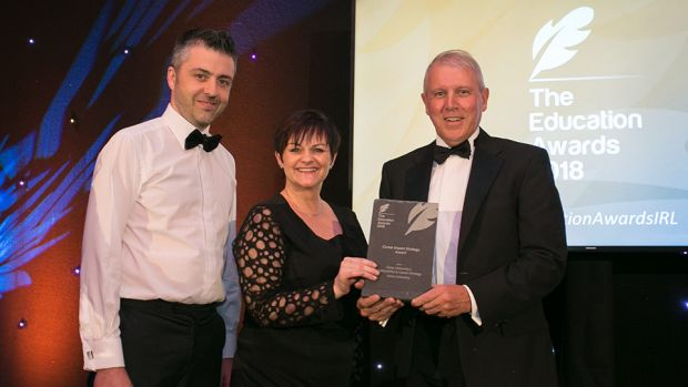 Lynn Willacy, Community and STEM Ambassador, Air Products presents the Career Impact Strategy Award to Damian McGivern & Brian Byers, Ulster University.