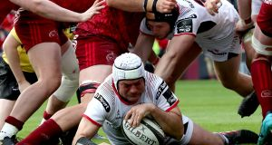 Ulster's Rory Best scores a try against Munster in April. Photograph: Billy Stickland/Inpho