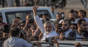 Hamas leader Sheikh Ismaeil Haneiya flashes the victory sign during his visit near the border with Israel in the east of Gaza Strip. Photograph: Mohammed Saber/EPA