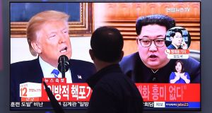 "TV  news screen showing US president Donald Trump and North Korean leader Kim Jong-un at a railway station in Seoul: ""We do not hide our feelings of repugnance towards him,"" said a  North Korean statement of US national security adviser John Bolton. Photograph: Jung Yeon-je/AFP/Getty"