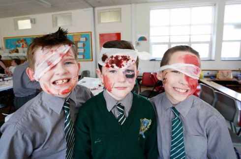 CINEMAGIC: Micheal Mongon (10), Reece Doona (9) and Darragh Cullen (9) at a special effects make-up workshop with Robert King at Francis Street CBS in Dublin as part of Cinemagic International Film and Television Festival for Young People. Photograph: Sasko Lazarov/Photocall Ireland