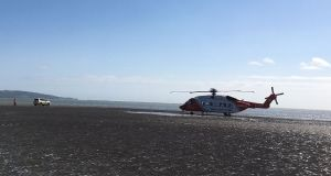 The Coast Guard helicopter which was tasked on Wednesday morning to lift a woman and her dog from a sandbank on Sandymount strand when they were cut off by an incoming tide.