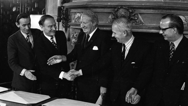 British prime minister Edward Heath, centre, with, from left, Alliance's Oliver Napier, taoiseach Liam Cosgrave, unionist leader Brian Faulkner and SDLP leader Gerry Fitt sign the Sunningdale, agreement in December 1973. Photograph: Independent News and Media/Getty Images
