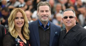 Gotti: Kelly Preston, John Travolta and John A Gotti in Cannes. Photograph: Loic Venance/AFP/Getty
