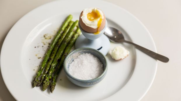 Boiled eggs and asparagus soldiers. Photograph: Emma Jervis