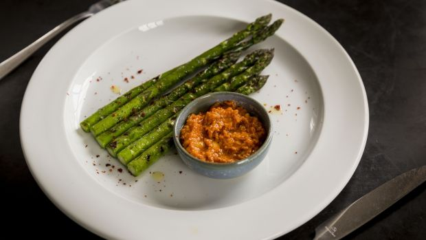 Chargrilled asparagus and romesco. Photograph: Emma Jervis
