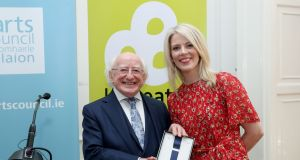 President Michael D Higgins presents  Sarah Crossan with her laureate's medal as shje became the fifth Laureate na nÓg today. Photograph: Maxwells