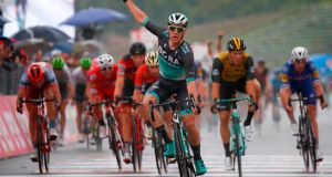 Sam Bennett celebrates as he crosses the line to take Stage 12 of the Giro D'Italia. Photograph: Luk Benies/AFP