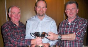 Bill Fegan (centre), winner of Wicklow Anglers' competition, with committee members John Cox (left) and Ronan Megren
