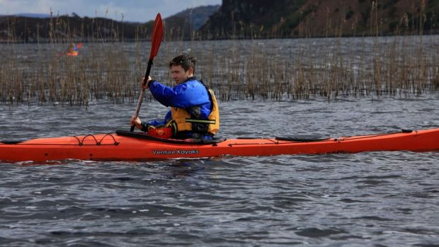 Eamon tries his hand at kayaking on Caragh Lake.
