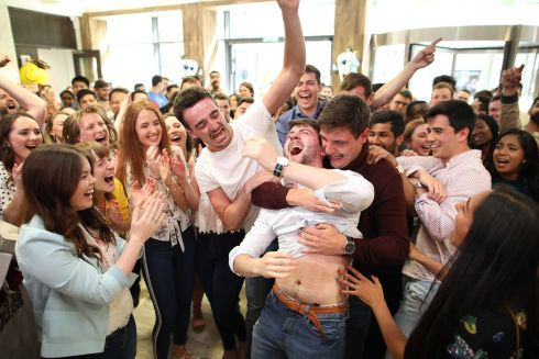 Dr Paul Fox from Wexford celebrates at the Royal College of Surgeons in Ireland with his friends after getting his final medicine results. Photograph: Julien Behal