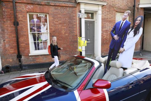 Cardboard cutouts of Harry Windsor and Meghan Markle set up in a car decorated with the colours of the Union Flag in Windsor. Photograph: Andersen/AFP/Getty Images