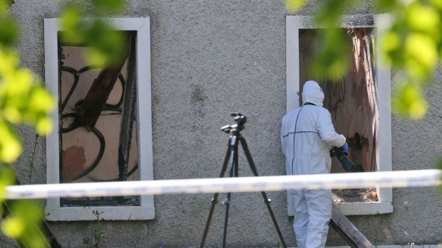 Gardaí at the scene at a derelict house and farmyard on the Clonee Road, Lucan where the body of Anastasia 'Ana' Kriegel was found. Photograph: Collins