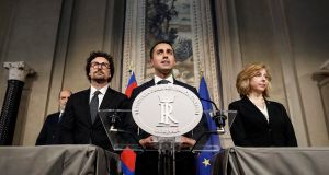 Five-Star Movement leader Luigi Di Maio, centre, flanked by his party colleagues Giulia Grillo, right, and Danilo Toninelli. Photograph: Riccardo Antimiani/ AP