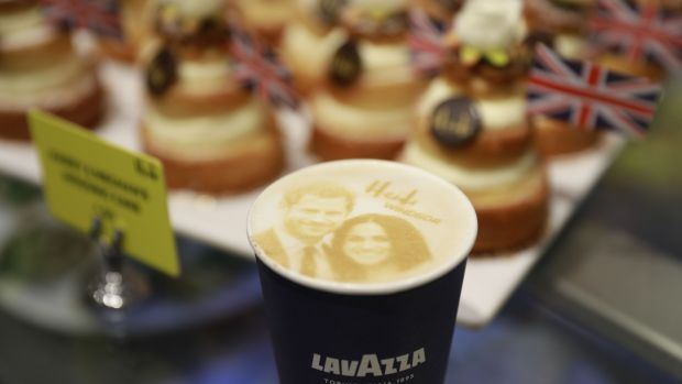 A picture shows a 'Megharryccino', a Royal Wedding-themed coffee decorated with the faces of Britain's Prince Harryand Meghan Markle, in a coffee shop in Windsor. Photograph: Andersen Odd/AFP/Getty Images