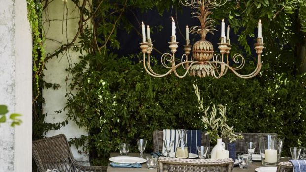 Add drama to your outdoor space with an elaborate rococo candelabra.