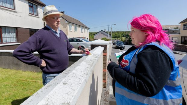 Enya Kennedy, on the Yes campaign canvas in Castlecomer, Co Kilkenny, speaking to Seamus Dunne from Hillside View, Castlecomer. Photograph: Dylan Vaughan