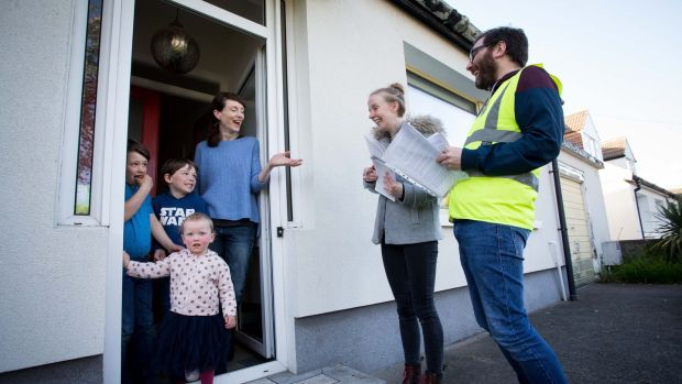 Together For Yes canvassers Sarah Halpin and Paddy Delaney in Perrystown, Dublin 12, speak to Pauline Fleming, with her children, Cohen Heenan (8), Ailbe Heenan (5) and Ruby Heenan (2). Photograph: Tom Honan