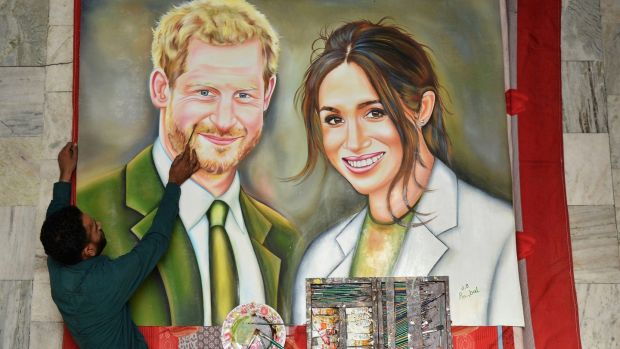 Indian artist Jagjot Singh Rubal puts the final touches to a painting of Prince Harry and Meghan Markle, which he plans to send as a gift for their wedding, in Amritsar, India, on Friday. Photograph: Prabhjot Gill/AP
