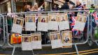 London barriers decorated with a royal family version of the Top Trumps card game. Prince Harry and Meghan Markle will marry on Saturday in Windsor Castle. Photograph: Paul Ellis/AFP/Getty Images