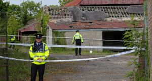Gardaí continue their investigations at the derelict house and farmyard on the Clonee Road, Lucan, where the body of 14 year old Ana Kriegal was found on Thursday. Photograph: Collins Dublin