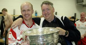 Oliver McVeigh holding the Sam Maguire with Peter Canavan in the changing rooms at Croke Park after Tyrone's  first All-Ireland win in 2003. Photograph: Oliver McVeigh/Sportsfile