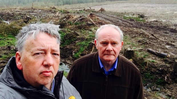 Oliver McVeigh with Martin McGuinness at Bragan bog in Co Monaghan, where the body of Columba McVeigh is supposed to be buried. Photograph: Oliver McVeigh