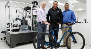 From left:  Arevo Labs chief executive Jim Miller, CTO Wiener Mondesir, and chairman and co-founder Hemant Bheda  with the company's 3D-printed carbon fibrecommuter bike