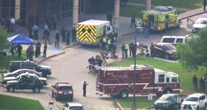 Emergency personnel and law enforcement officers respond to a high school near Houston after an active shooter was reported on campus in Santa Fe, Texas. Photograph: KTRK-TV ABC13 via AP