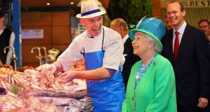 Queen Elizabeth II meets fishmonger Pat O'Connell at the English Market on May 20th, 2011, in Cork. Photograph: Getty Images