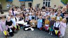 Ireland's oldest primary school. Children, suitably attired, from Powerscourt National School celebrate 200 years in Enniskerry with the release of doves. Photograph: Cyril Byrne / The Irish Times
