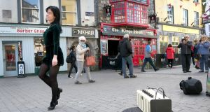 Dancer Emma O'Sullivan performs to music from her small amplifier while busking in Galway city centre. Photograph: Joe O'Shaughnessy