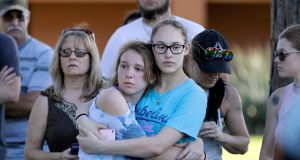 Mourners wait for the start of a prayer vigil following the shooting at Santa Fe High School in Santa Fe, Texas, on Friday. Photograph: AP