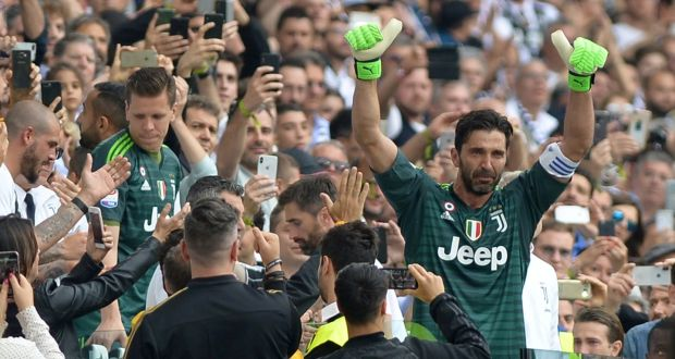 4376213eb3f Juventus goalkeeper Gianluigi Buffon gestures to the fans as he is  substituted off in the Serie