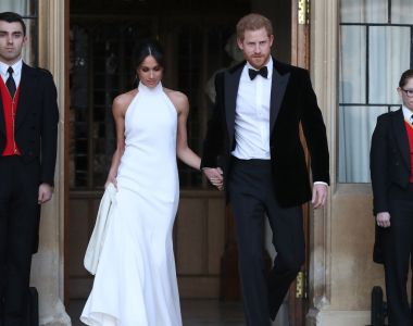 Duchess of Sussex Meghan Markle and Prince Harry, Duke of Sussex, wave as  they