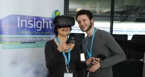 Aaron Dunne from DCU pictured show an VR machine to Antonelle Ferrecchia EU Programme manager for Insight.