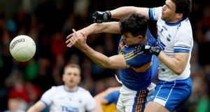 Tipperary's Michael Quinlivan in action against Stephen Prendergast of Waterford during the Munster senior football quarter-final at Semple Stadium. Photograph: Tommy Dickson/Inpho