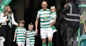 Scott Brown of Celtic is seen with his children during the Scott Brown testimonial match between Celtic and Republic of Ireland XI at Celtic Park. Photo: Ian MacNicol/Getty Images
