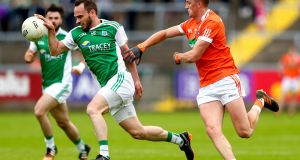 Fermanagh's Paul McCusker and Armagh's Connaire Mackin tussle during the Ulster football senior championship quarter-final at Brewster Park. Photograph: James Crombie/Inpho
