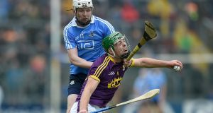 Dublin's Fiontan McGibb challenges   Wexford's Aidan Nolan during the Leinster SHC round-robin game at  Innovate Wexford Park. Photograph: Tommy Greally/Inpho