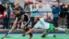 Conor Harte challenges Germany's Johannes Grobe during Ireland's 2-1 victory at Pembroke Wanderers Hockey Club in Dublin. Photograph: Gary Carr/Inpho