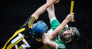 Kilkenny's John Donnelly and Ben Conneely of Offaly compete for the ball. Photograph: Lorraine O'Sullivan/Inpho