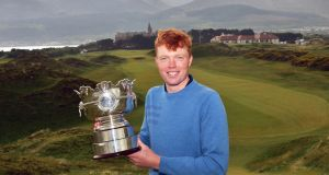 Tramore's Robin Dawson with the Flogas Irish Amateur Open trophy at Royal County Down Golf Club. Photograph: Pat Csahman