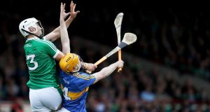 Tipperary's Donagh Maher goes up with Limerick's Aaron Gillane at the Gaelic Grounds on Sunday. Photograph: Tommy Dickson/Inpho