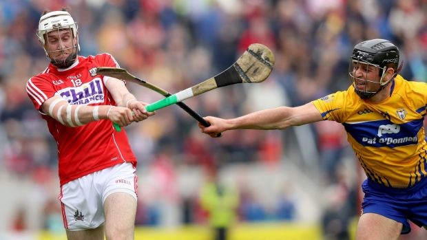 Cork's Tim O'Mahony is blocked by Clare's Cathal Malone during the Rebels victory at Páirc Uí Chaoimh. Photograph: Oisín Keniry/Inpho