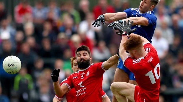 Tyrone's Tiernan McCann and Cathal McShane with Dessie Ward of Monaghan during the visitors' victory at Healy Park in Omagh. Photograph: James Crombie/Inpho