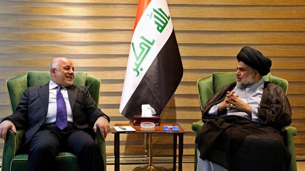 IIraqi prime minister Haider al-Abadi meeting with Muqtada al-Sadr in Baghdad on Sunday. Photograph: Iraqi government via AP