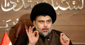 Shia cleric Muqtada al-Sadr: did not run as a candidate and has ruled himself out as prime minister – but made clear whom he considers natural political allies. Photograph:  Karim Kadim/AP