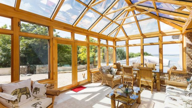 The house faces south, ensuring that even in winter, the sun room – which spills out onto a barbeque terrace – is warm