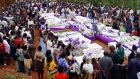 People pay their respects in front of dozens of coffins containing remains of more than 600 victims of the 1994 genocide in Rwanda. File photograph: Themistocles Hakizimana/Reuters